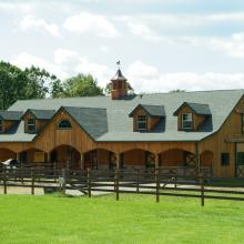 Outdoor photo of horse barn