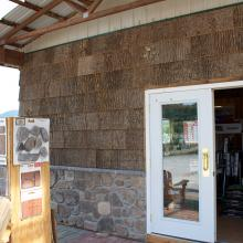 Bark siding on exterior of store